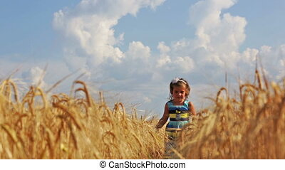 girl running through the wheat field - Little girl running...
