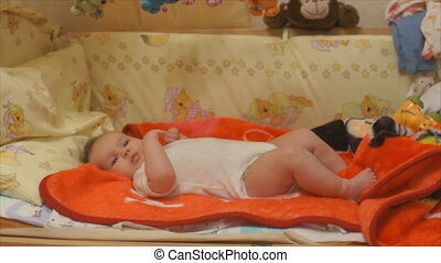 thoracic infant child plays on the bed - Newborn baby...