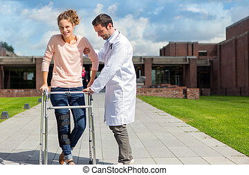 Young doctor assisting a young woman - VIew of a Young...