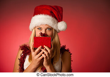 Attractive young blonde woman in santa claus dress -...