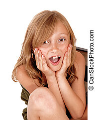 Surprised young girl - A surprised young blond girl holding...