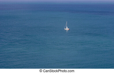 Lonely sailing yacht in the sea