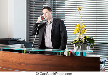 Office worker talking on the phone - Office worker talking...