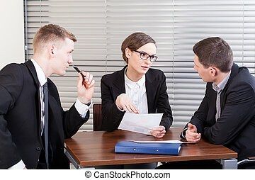 Business team trying to resolve problem at work