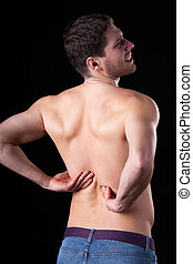 Man with backpain - Man with pain of lower part of backbone