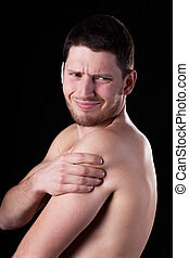 Pain of rotator cuff - Young man suffering from pain of...