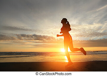 Running sport woman - Sport young woman running on the beach...