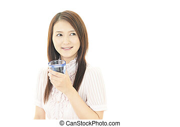 Young woman drinking water - Portrait of young woman...