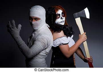 Halloween concept with mummy and woman with axe