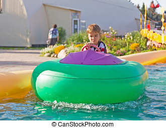 child on an inflatable boat