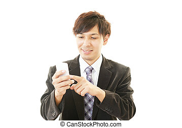 Happy man holding smart phone - The male office worker who...