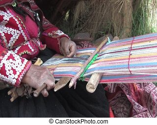 Weaving a rug in Peru - Woman weaving a rug in Peru