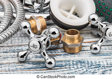 plumbing and accessories on wooden table
