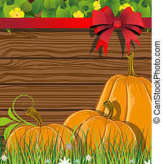 Pumpkins on the wooden background - Pumpkins with leaves and...