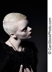 Individuality. Glamorous Well-dressed Blond Woman with Short Haircut