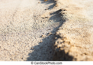 Sand surface with the relief formed by water currents - Sand...
