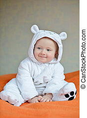 ?ute baby boy wearing costume of polar bear