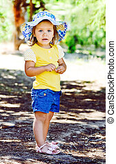 ?ute and fashion - stylish little girl standing outdoors