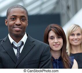 Afro-American businessman in front of his colleages -...