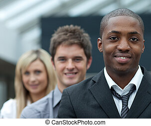 Portrait of an Afro-American businessman leading his team