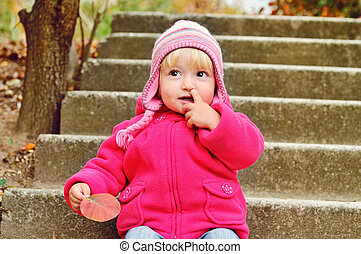 girl picking nose - baby girl picking her nose outdoors