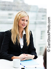 Beautiful businesswoman in a meeting
