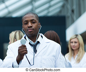 Handsome Afro-American doctor leading his team - Handsome...