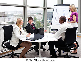 Business people working together in an office - Multi-ethnic...