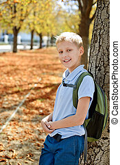schoolboy in fall - schoolboy with backpack after school in...