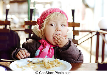 baby in outdoor cafe - baby girl eating in outdoor cafe