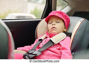 girl sleeping in car seat