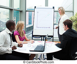 Beautiful businesswoman giving a presentation to her team