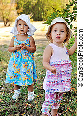 two baby girls in summer time
