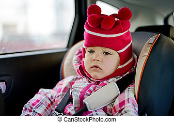 baby girl in car seat in winter time