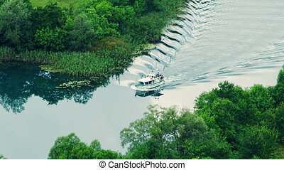 Boat floats Krka river - Tourist boat floats Krka river in a...