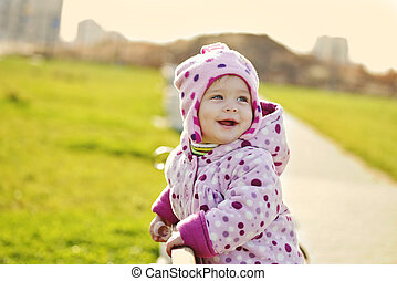 happy baby in the park