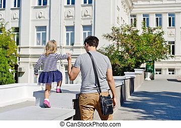 father and daughter - young father and daughter are walking...