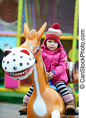 toddler in theme park - toddler girl in theme park on the...