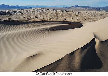 Sand Dune - A sand dune is windswept by the desert winds.