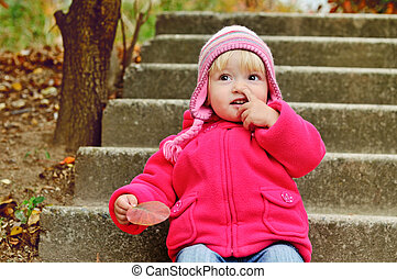 girl picking her nose - baby girl picking her nose outdoors