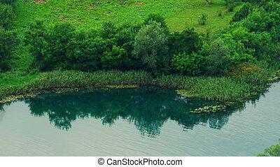 Krka riverside - Green Krka river scenery along the coast.
