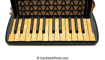 Keyboard of vintage 1930s black accordion closeup isolated