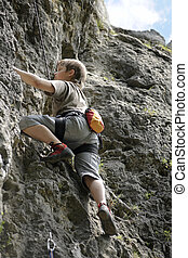 climber - young sportsman climbing on the rock