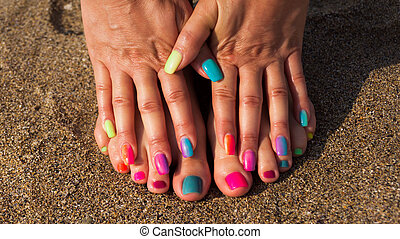 Pedicure and manicure with colorful  nails