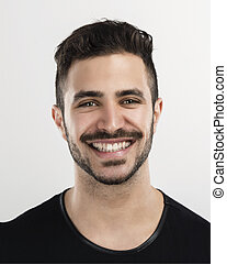 Young man laughing - Studio portrait of a handsome young man...