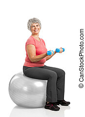 Fiitness old woman - Happy fitness old woman lifting...