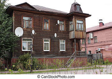 old wooden house with television antennas - old wooden...