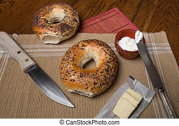 Bagels - New York style bagels in setting with butter and...
