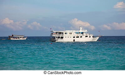 Divers ship ancored not far from the shore. Similan Islands,...