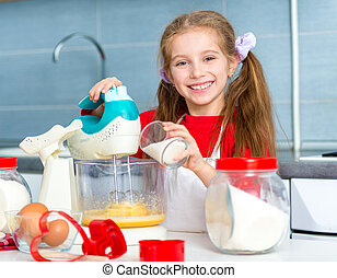 little girl preparing cookies to valentine's day